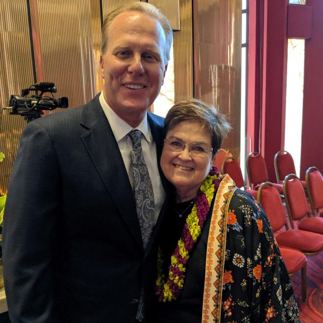 Mayor Kevin Faulconer poses with Carolyn Satter at her retirement event.